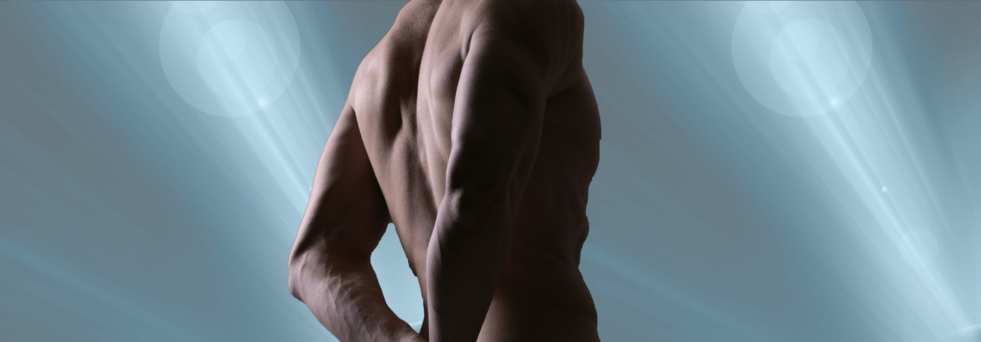 image of a mans back with arms crossed behind